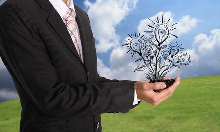 smart goals: Businessman hand holding light bulb illustration idea concept