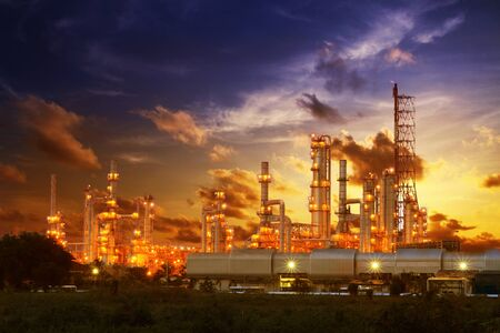 Refinery of petrochemical industry on sunset background Banco de Imagens