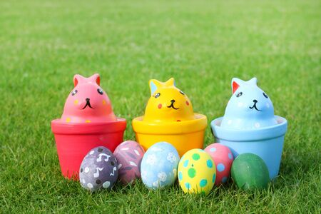 cup: Ceramic rabbit with eggs on grass on Easter day Stock Photo