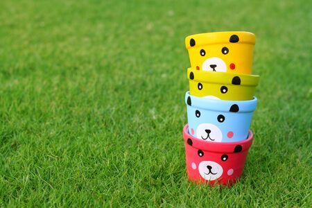 Cup pastel bears lined up in the grassy background.