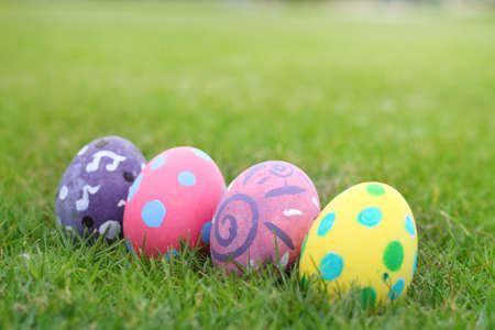 Eggs painted pastel line in the grass background.