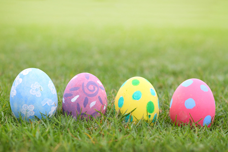 Eggs pastel lined on grass background in ester day Stock Photo