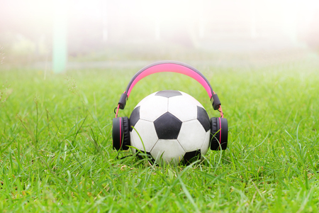 funny football music on green grass  and light background