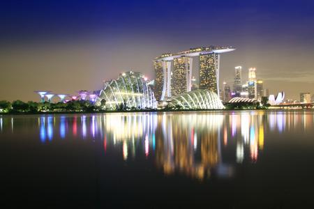 Reflection of light building beautiful sunset at Singapore