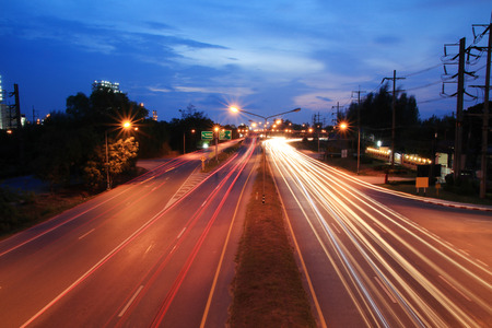 Car light trails Rayong province to Pattaya in Thailand .Motion Red Speed Light on road to Pattaya Thailand