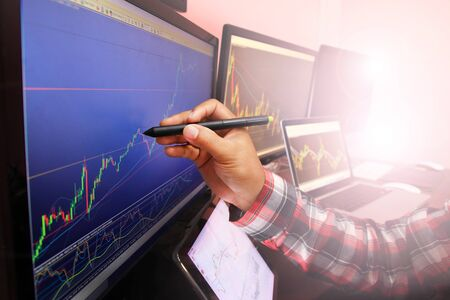 Businessmen are analysing stocks. For investment in stocks concept background
