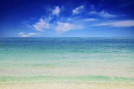 Emerald sea water with the bright sky. Tropical beautiful summer sea and clouds holiday background Imagens