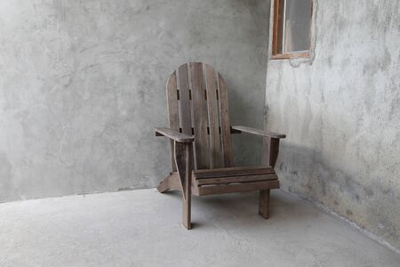 Wooden chairs object on cement wall background horizontal view Imagens