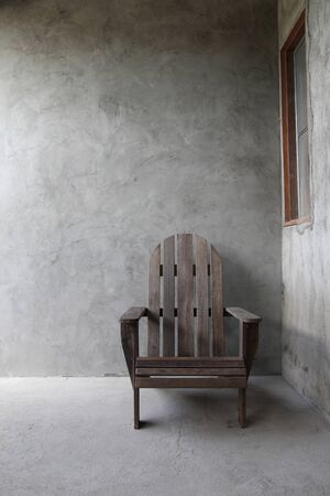 Wooden chairs object on cement wall background vertical view Imagens