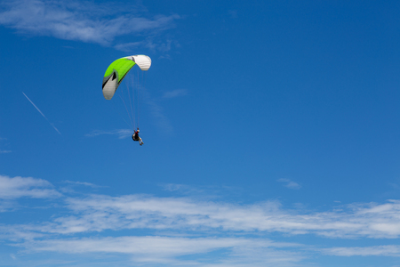 free dive: Paragliding in sky over blue sea