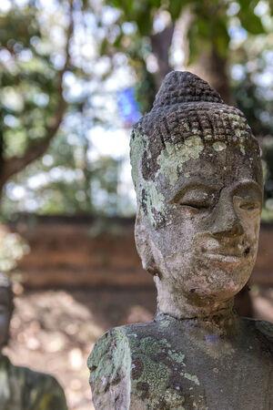 Damaged handless buddhist statue photo