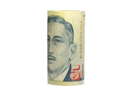 Rolled Singapore dollar notes photo