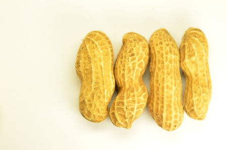 Four peanuts in a row Stock Photo - 8970601