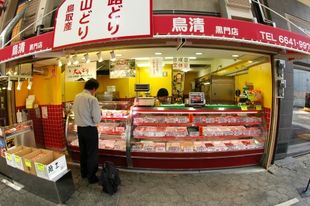 Customer is buying chicken meat at Kuromon market,  Osaka
