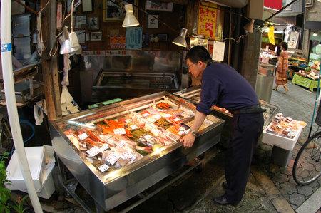 Customer is selecting the seafood at Kuromon market,  Osaka