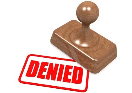 Denied word on wooden stamp photo