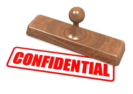 Confidential word on wooden stamp Stock Photo - 19046791