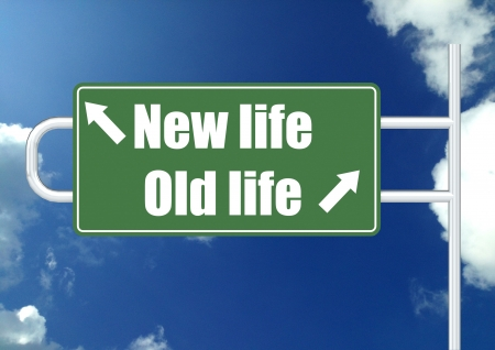 new beginning: New life old life road sign Stock Photo