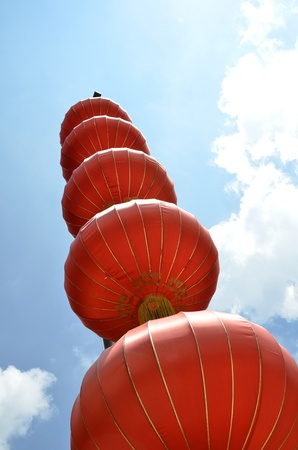 Red lanterns against blue sky photo