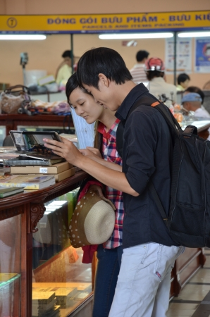 Tourists shop for souvenir in Vietnam post office