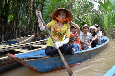 freshwater sailor: Tourists on the boat ride along Mekong river
