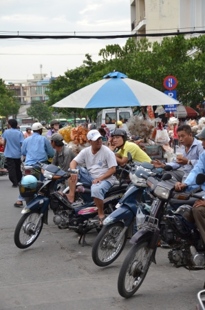Cyclist in Vietnam street Stock Photo - 21418084