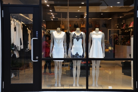 Boutique display window with mannequins in fashionable dresses Stock Photo - 24651288