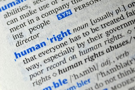 trafficking: Human right word on book Stock Photo