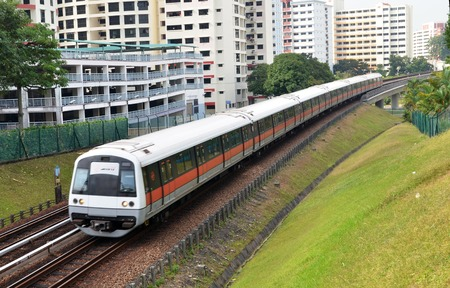 rapid: Singapore mass rapid train travels on the track Editorial