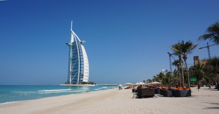 View of Burj Al Arab hotel from the Jumeirah beach. Burj Al Arab is one of the Dubai landmark, and one of the worlds most luxurious hotels with 7 stars