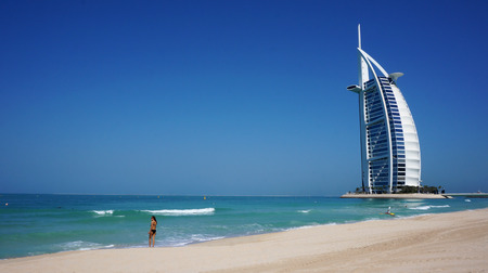 View of Burj Al Arab hotel from the Jumeirah beach. Burj Al Arab is one of the Dubai landmark, and one of the world's most luxurious hotels with 7 stars Editorial