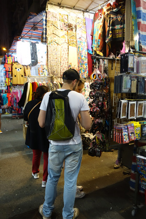 priced: HONG KONG - NOVEMBER 22 :Tourist shops for bargain priced fashion and casual wear in Mong Kong night market on 22 November 2014. The busy night market is famous with many booths setting up to sell local products.