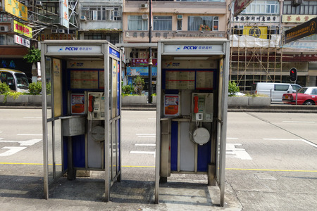 cell phone booth: HONG KONG - NOV 21: Two phone booths locate in Mong Kok on November 21, 2014 in Hong Kong, China. As cell phone getting more popular, phone booth is rarely seen in Hong Kong today.