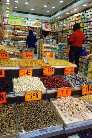 HONG KONG - NOVEMBER 23: Shoppers visit the dry food shops on November 23, 2014 in Hong Kong. Hong Kong is famous for selling seafood since the 19 century.