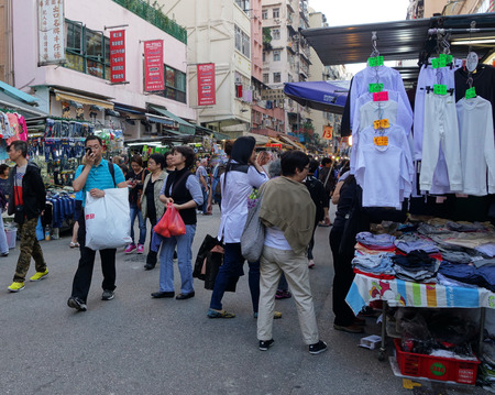 priced: HONG KONG - NOVEMBER 22 :Tourist shops for bargain priced fashion and casual wear in Mong Kong market on 22 November 2014. The market is famous with many booths selling local products.