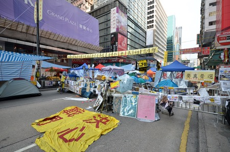 HONG KONG, NOV 23: Roadblock is set up to prevent police to conduct the raid in Mong Kok on 23 November 2014. Hong Kong activists are fighting for their right to choice for the next chief executive.