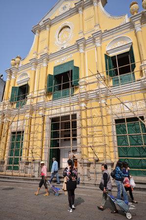 MACAU, CHINA - NOV 19: Tourists visit historical buildings surround the Leal Senado Squarein Macau on November 19, 2014. Macau is a former Portuguese colony. Editorial