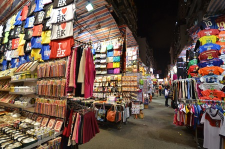 bargain for: HONG KONG - NOVEMBER 22 :Tourist shops for bargain priced fashion and casual wear in Mong Kong market on 22 November 2014. The market is famous with many booths selling local products.