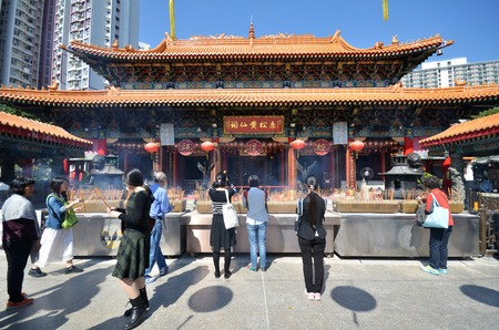 tourist spot: HONG KONG - NOVEMBER 22, 2014 - Hong Kong people visit the Wong Tai Sin Buddhist Temple to pray on November 22, 2014, in Hong Kong. Wong Tai Sin Temple is very famous tourist spot in Hong Kong.