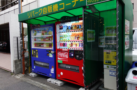 capita: KYOTO, JAPAN - DEC 9: Vending machines located on the street in Kyoto on December 09, 2014. Japan has the highest number of vending machine per capita in the world at about one to twenty three people. Editorial