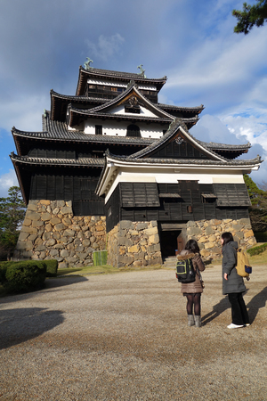 feudal: SHIMANE, JAPAN - DECEMBER 06: Tourists visit Matsue samurai feudal castle in Shimane prefecture on December 06, 2014., This castle also known as Black castle in Shimane prefecture.