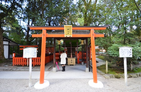 KYOTO, JAPAN - DEC 09: Tourists visit Shimogamo shrine orange archway in Kyoto, Japan on December 09, 2014. Shimogamo Shrine is one of the oldest shrines in Japan and is a World Heritage Site.