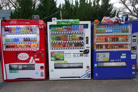 capita: KYOTO, JAPAN - DEC 9: Vending machines located on the street in Kyoto on December 09, 2014. Japan has the highest number of vending machine per capita in the world at about one to twenty three people Editorial