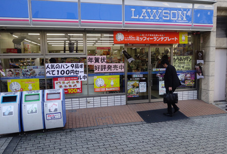 lawson: HIROSHIMA, JAPAN - APRIL 22: Customers visit Lawson Station store on April 22, 2012 in Hiroshima, Japan. Lawson is one of largest convenience store franchise chains in Japan with 10,326 shops. Editorial