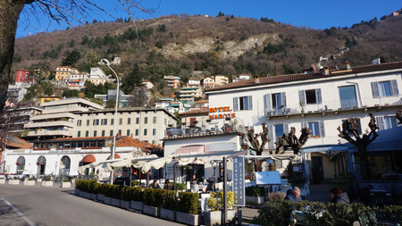 COMO, ITALY, JAN 26: Tourists visit resort town at Lake Como in Varenna, Italy on January 26, 2015. Lake Como is the third largest lake in Italy and the most visited resort near Milan.