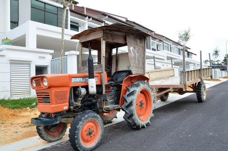 terrace house: JOHOR, MALAYSIA- FEB 06: A truck parks in front of a newly build terrace house in Johor, Malaysia on February 6, 2015. Real estate market in Johor has been raising for the past few years.
