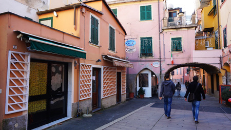 monterosso: MONTEROSSO, ITALY- JAN 17: Pedestrians walk through a square of restaurants and bars along the coast of Cinque Terre in Monterosso, Italy on January 17, 2015.