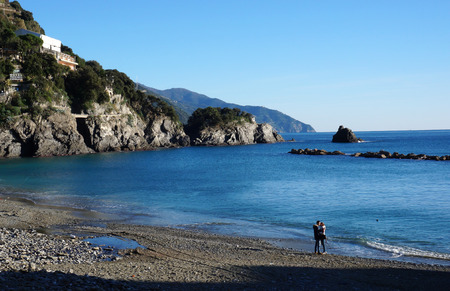 monterosso: MONTEROSSO, ITALY- JAN 17: A couple visit beach in Monterosso, Italy on January 17, 2015.The beach at Monterosso runs along most of the coast line and is well used by tourists and locals.