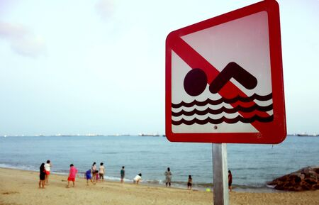 no swimming: A no swimming danger sign at the beach