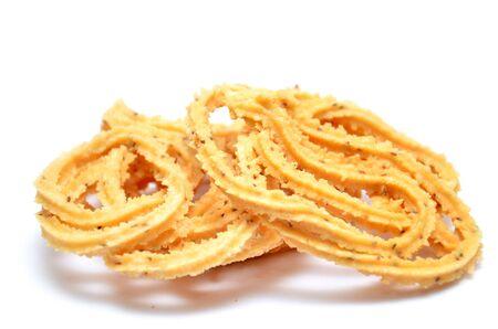 muruku: Traditional indian snack - chakali, isolated on white.
